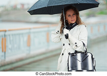 Woman with umbrella - Thoughtful woman with umbrella in the...