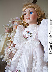 Collection of vintage porcelain dolls in Victoriian and...