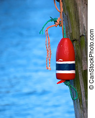 Lobster Buoy - Colorful lobster / fishing buoy hanging on a...