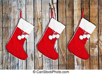 Christmas socks   - Christmas socks hung on a wooden wall