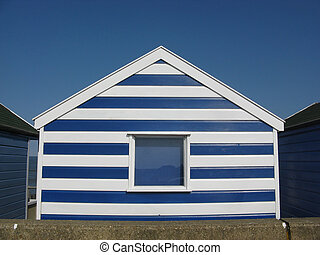 Striped beach hut in Southwold - Blue and white beach hut on...