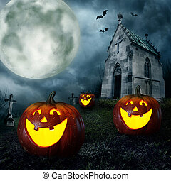 Halloween pumpkins and cemetery chapel at night