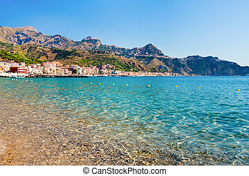 view on Taormina and Gardini Naxos beach, Sicily - view on...