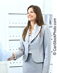 business woman shaking hands with a man in her office