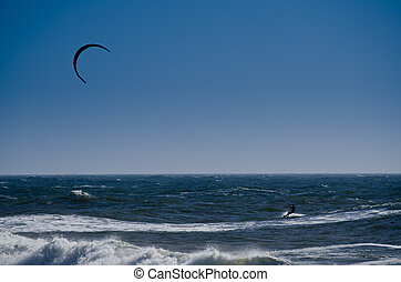 Kite surfer - Silhouette of a kite surfer on the ocean.