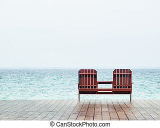 Beach resort - Two empty chair at a resort facing the south...