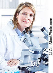 Laboratory - Woman working with a microscope in laboratory