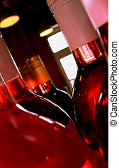 Wine Bottles Pink - Very close up shot of several bottles of...