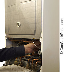 Servicing Gas Combination Boiler - Servicing hot water gas...