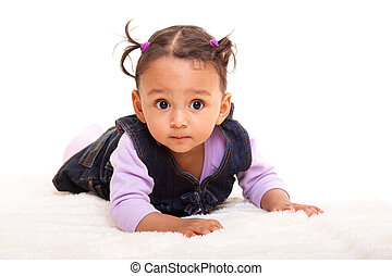 Beautiful biracial baby girl lying on the floor - Beautiful...