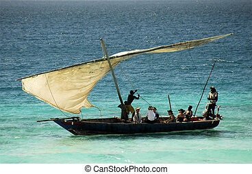 Fishermen on Zanzibar Island - Fishermen going out to sea at...