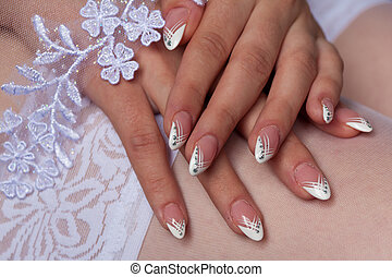 Brides manicure on lace stockings