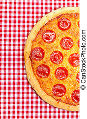 Pepperoni Pizza Half - Pepperoni pizza half on red gingham...