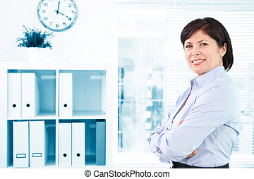 Happy employer - Mature businesswoman looking at camera in...