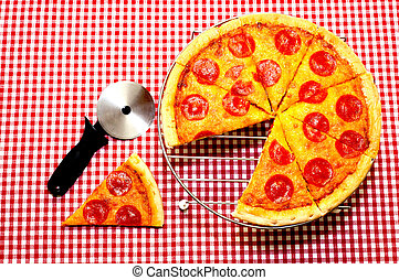 Whole Pepperoni Pizza and Cutter