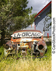 Abandoned car along US Route 66 showing Los Angeles in one...