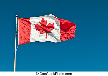 Waving Canadian Flag with Blue Sky - A Canadian flag waves...