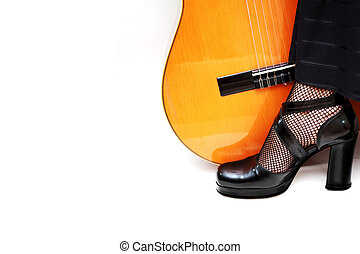 flamenco dance concept - dancers foot with acoustic guitar