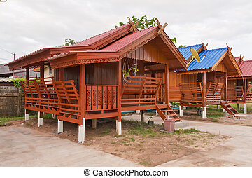 Wooden Thai northern style house tilted right - Wooden Thai...