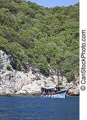 classic boat anchored in open sea