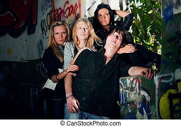 Teens in the abandoned house - Young friends in the grungy...