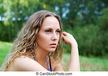 Sad young woman - Thoughtful young woman looking away on...