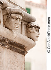 Sibenik cathedral - Famous faces on the side protal of...