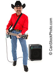 Attractive elderly country musician with electric bass guitar, boots, cowboy hat at age 75 over white background.