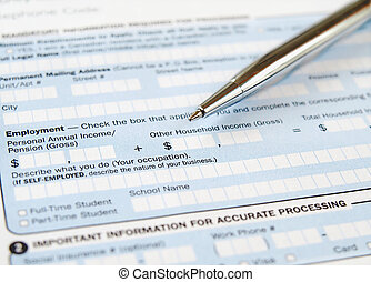 Pen on the application form - Closeup of the pen on the...