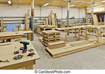 a plant for manufacturing of furniture - The photograph...