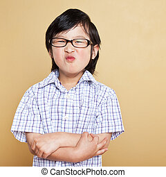 Cute asian boy - A portrait of a cute asian boy making a...