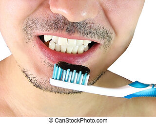 Closeup of man, brushing teeth with a blue tooth brush