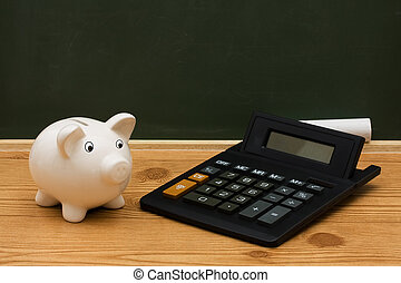 Cost of an education - A piggy bank with calculator and...