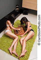 Sexy females playing chess