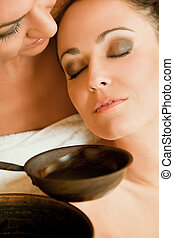 Females in sauna - Close-up of two beautiful women enjoying...