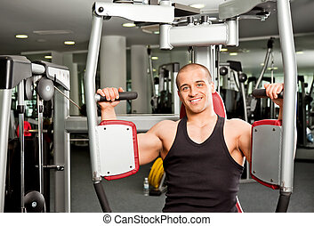 male working out - Athletic male doing fitness training on...