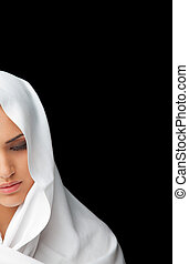 Female covered half face veil - half face of a young female...