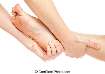 Foot massage - Woman hands giving a gentle foot massage...