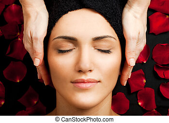 spa face massage - Beautiful young woman receiving face...