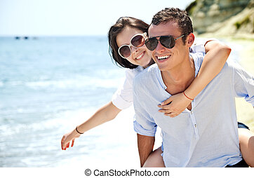 Couple love freedom - piggyback ride to beautiful female on...
