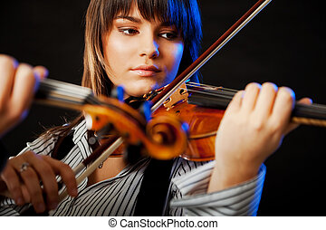 Violinist concert - portrait of a beautiful young violinist...