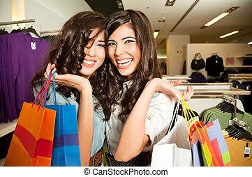 smiling girls shopping