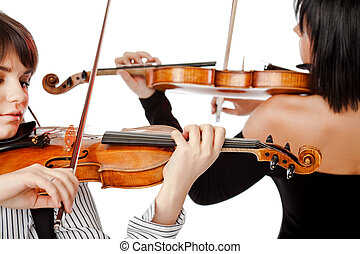 Violinists isolated - Two female violinists playing violins...