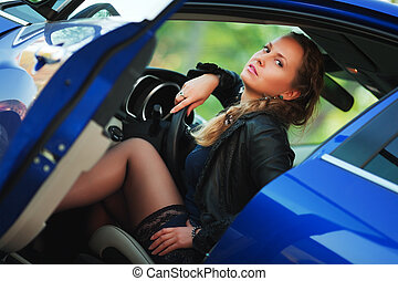 Young woman in a car - Beautiful young woman sitting in a...