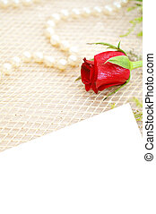 romantic background with rose and pearls