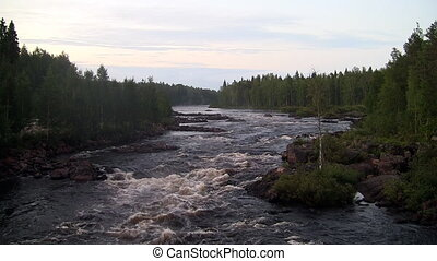 rough river flows through the forest Scandinavia