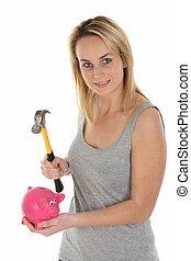 Pretty Girl Opening Piggy Bank with Hammer