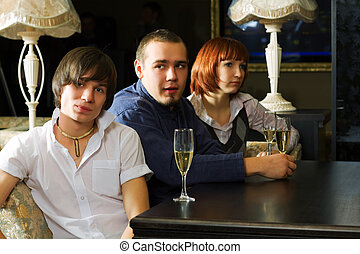 Young people relaxing in a bar - Young people drinking...