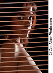 Woman looking trough window - Sensual hispanic woman looking...
