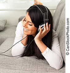 girl listening music on the sofa